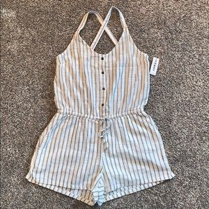 Gray and white romper with buttons.